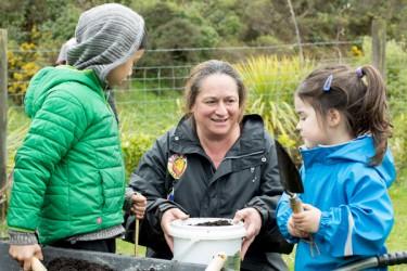 Adult and children gardening.