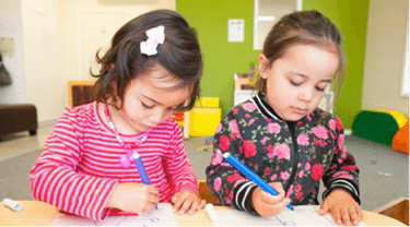 Two children drawing.
