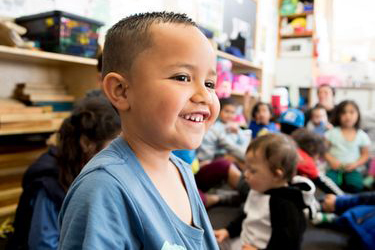 Child smiling at early childhood service.