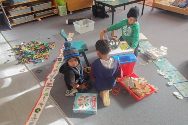 Children playing with puzzles and toys.