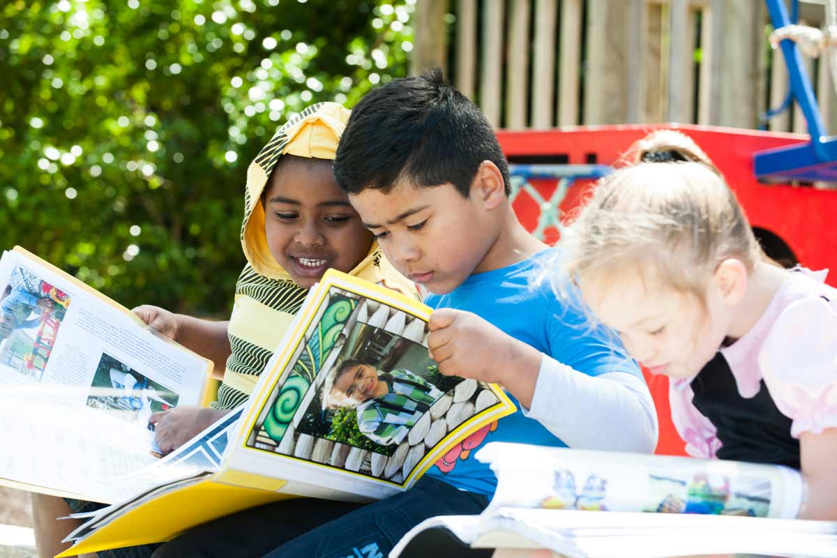 Children reading their stories together.