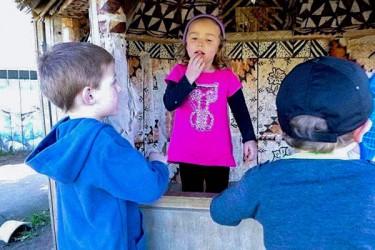 Children learning sign language.